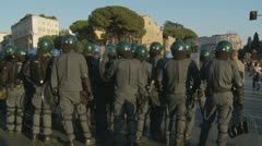 Riot police turn holding batons, Rome Stock Footage