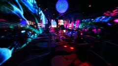 People in nightclub with bright LED illumination on walls Stock Footage