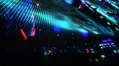 Large LED screen size of entire wall with changing picture in nightclub Stock Footage