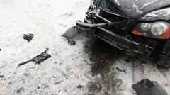 Strongly battered car is on icy road with flashing emergency lights and around Stock Footage