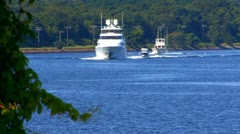 Extravagant Yacht cruses canal; 3 - stock footage