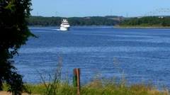 Extravagant Yacht cruses canal; 4 - stock footage