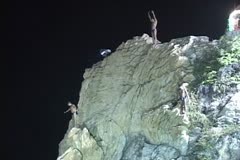 3 Acapulco cliff divers from below - stock footage