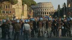 Riot police in Rome line the street - loud demonstrator Stock Footage