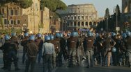 Stock Video Footage of Riot police in Rome line the street - loud demonstrator