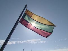 Lithuanian tricolor flag flies and the waves. Stock Footage