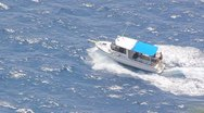 Boat running at the sea waves Stock Footage