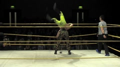 Mexican Lucha Libre wrestler gets knocked to the mat Stock Footage