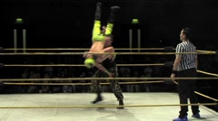 Pro wrestling - slam and leg drop dive off top rope - stock footage