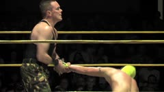 Pro wrestling wristlock submission hold Stock Footage