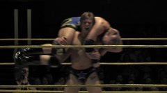 Pro wrestler finishes off his opponent - stock footage