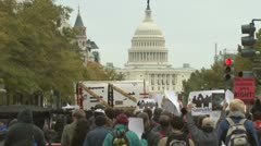 Angry Occupy Wall Street marches up to U.S. Congress  Stock Footage