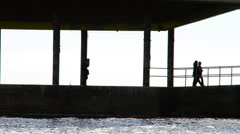 People, the sea, a shade Stock Footage