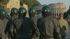 Police prepare for demo, Collosseum in the distance - stock footage