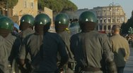 Stock Video Footage of Police prepare for demo, Collosseum in the distance