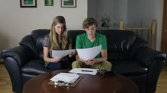Couple Checking Monthly Bills Stock Footage