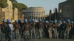 Large group of riot police face Collosseum in Rome Stock Footage