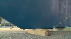 Boat keel lifting off blocks Stock Footage