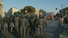 Italian riot police prepare. Collosseum in distance Stock Footage