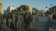 Stock Video Footage of Italian riot police prepare. Collosseum in distance