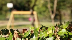 Child on swing - focus on foreground - stock footage