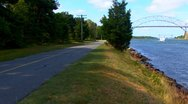 Cape Cod Canal; couple walking dog Stock Footage