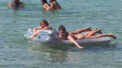 WorldClips-Girls on Rafts Stock Footage