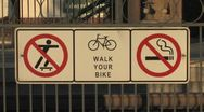 Stock Video Footage of Walk Your Bike Sign
