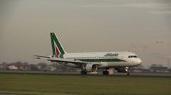 ALITALIA plane landing Stock Footage