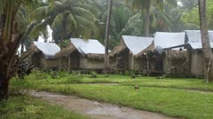 Huts at tropical resort during a monsoon Stock Footage