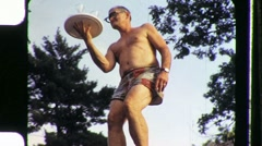 Man in Bathing Suit Brings Booze Circa 1955 (Vintage Film Home Movie) 1092 Stock Footage
