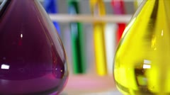 bright colored liquids in lab flasks - stock footage
