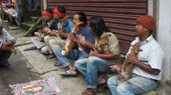 Indian musicians perform on the street in Darjeeling Stock Footage