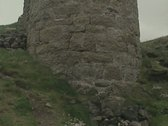Tilt up from base of stone tower Stock Footage