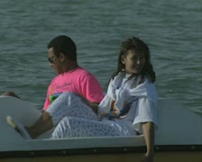 Close up of man and woman in a pedalo Stock Footage