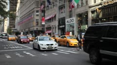 Yellow cab traffic 5th Avenue New York City urban street cars - stock footage