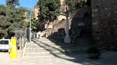 WorldClips-Alcazaba Fortress Tourists Leave-tilts Stock Footage