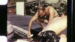 Pumping Gas in Boat Dockside Circa 1960 (Vintage Film 8mm Home Movie) 1106 Stock Footage
