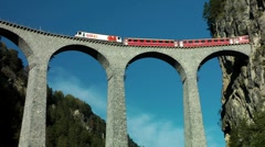 Alpine train on the Landwasser Viaduct, Switzerland, Schweiz - stock footage