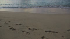 Footsteps at the sea beach Stock Footage