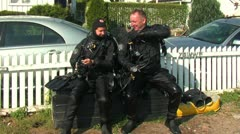 Divers on the shore Stock Footage