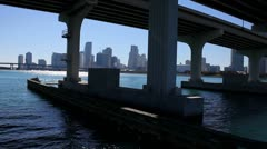 Miami skyline under bridge Stock Footage