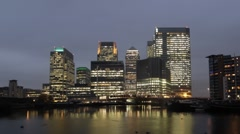 Time Lapse of London's Canary Wharf with Pond at Dusk Stock Footage