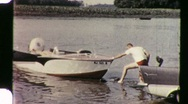 Stock Video Footage of Putting Small Boat in the Water Circa 1960 (Vintage Film 8mm Home Movie) 1105