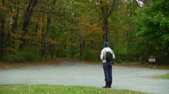 Hiker prepares to go into the forest (LP-Voorhees-021e) Stock Footage