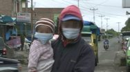 Man And Child Wear Face Masks To Protect Against Volcanic Ash Stock Footage