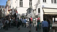 Tourists at the Manneken Pis, Brussels, Belgium Stock Footage