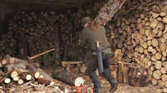 Woodcutter Unloading Log and Saw in Wood Shed Stock Footage