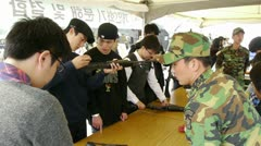 Koreans testing guns Stock Footage