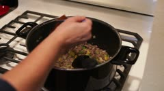 Cooking on kitchen stove. Stock Footage